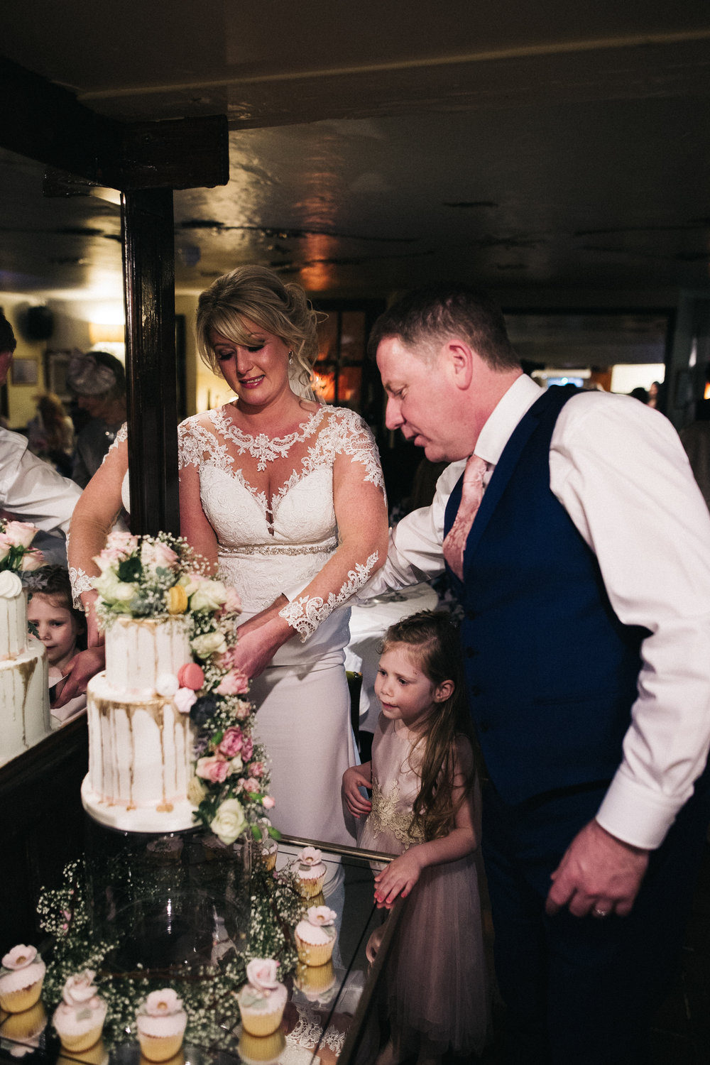 the bride and groom cut the cake. cleveland tontine wedding teesside north yorkshire - relaxed and creative wedding photographer