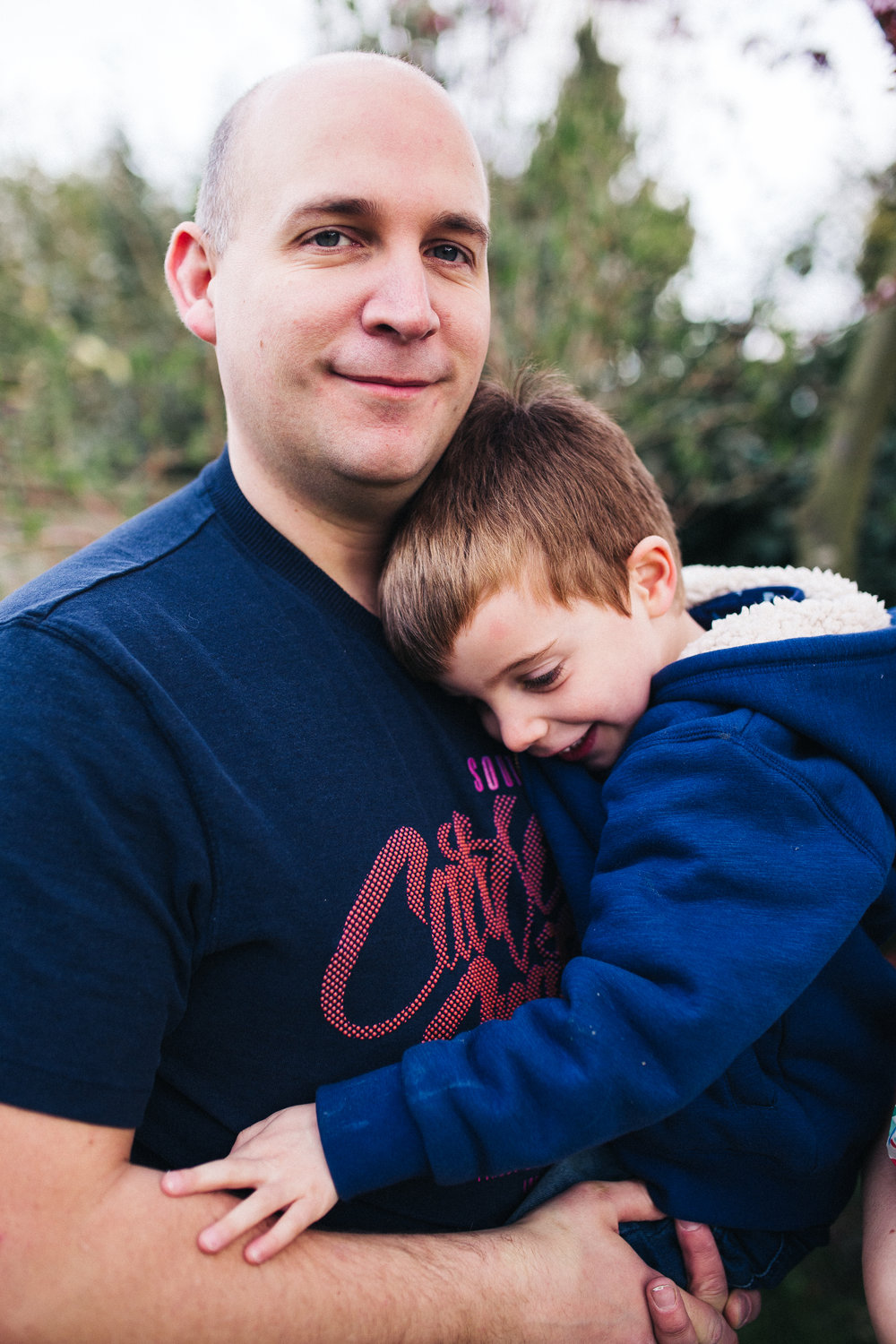 a dad cuddles his son. creative relaxed family photography teesside middlesbrough stockton north east