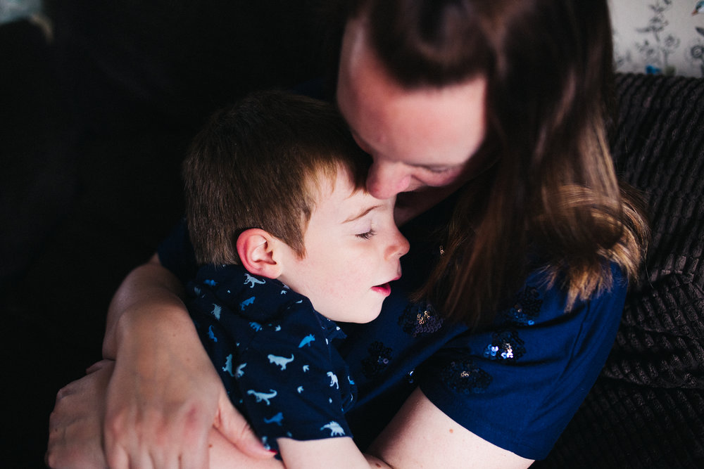 a mum snuggles her son. creative relaxed family photography teesside middlesbrough stockton north east