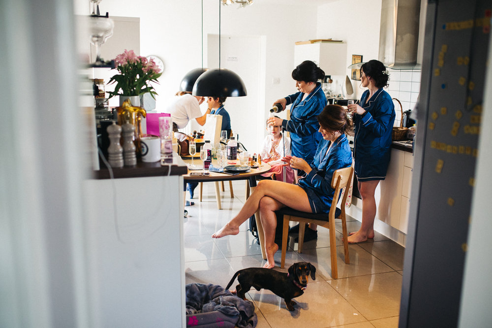 bridesmaids get ready around a kitchen table. ceremony at st georges hall liverpool, oh me oh my wedding reception, north west wedding photographer