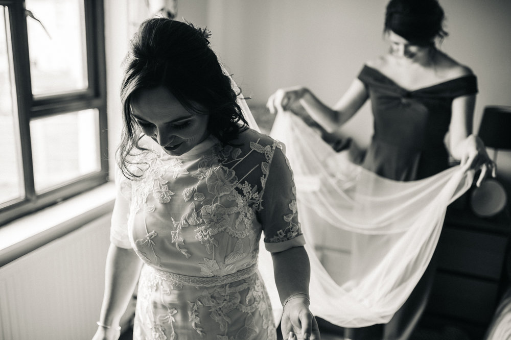 the bride having her veil fixed. ceremony at st georges hall liverpool, oh me oh my wedding reception, north west wedding photographer