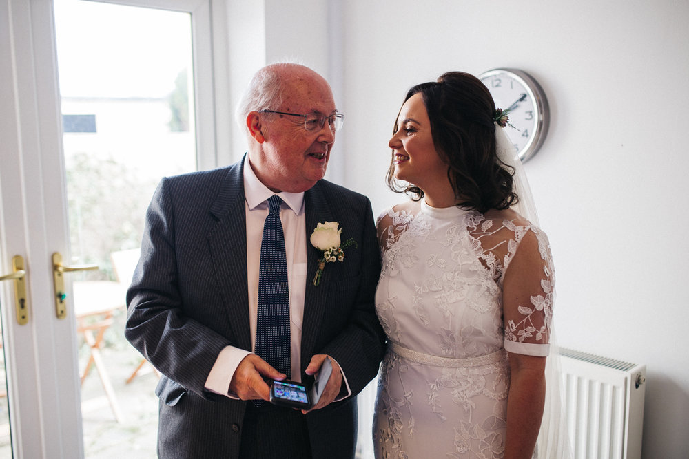 a bride and her dad smile at each other. ceremony at st georges hall liverpool, oh me oh my wedding reception, north west wedding photographer
