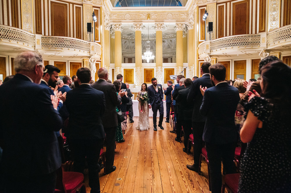 the couple walk back up the aisle. ceremony at st georges hall liverpool, oh me oh my wedding reception, north west wedding photographer