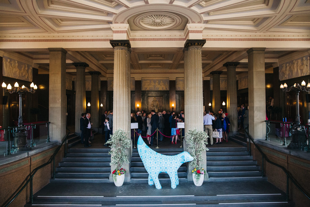 a wide shot of mingling guests with a superlambana in the foreground. ceremony at st georges hall liverpool, oh me oh my wedding reception, north west wedding photographer