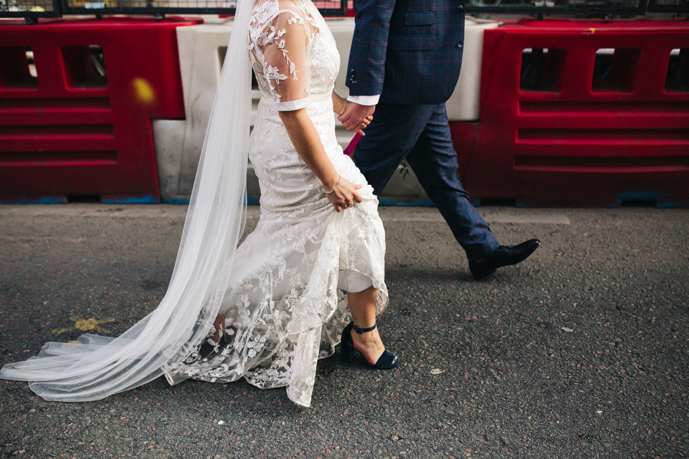 a shot showing the bride and groom's feet walking in front of building blockers. ceremony at st georges hall liverpool, oh me oh my wedding reception, north west wedding photographer