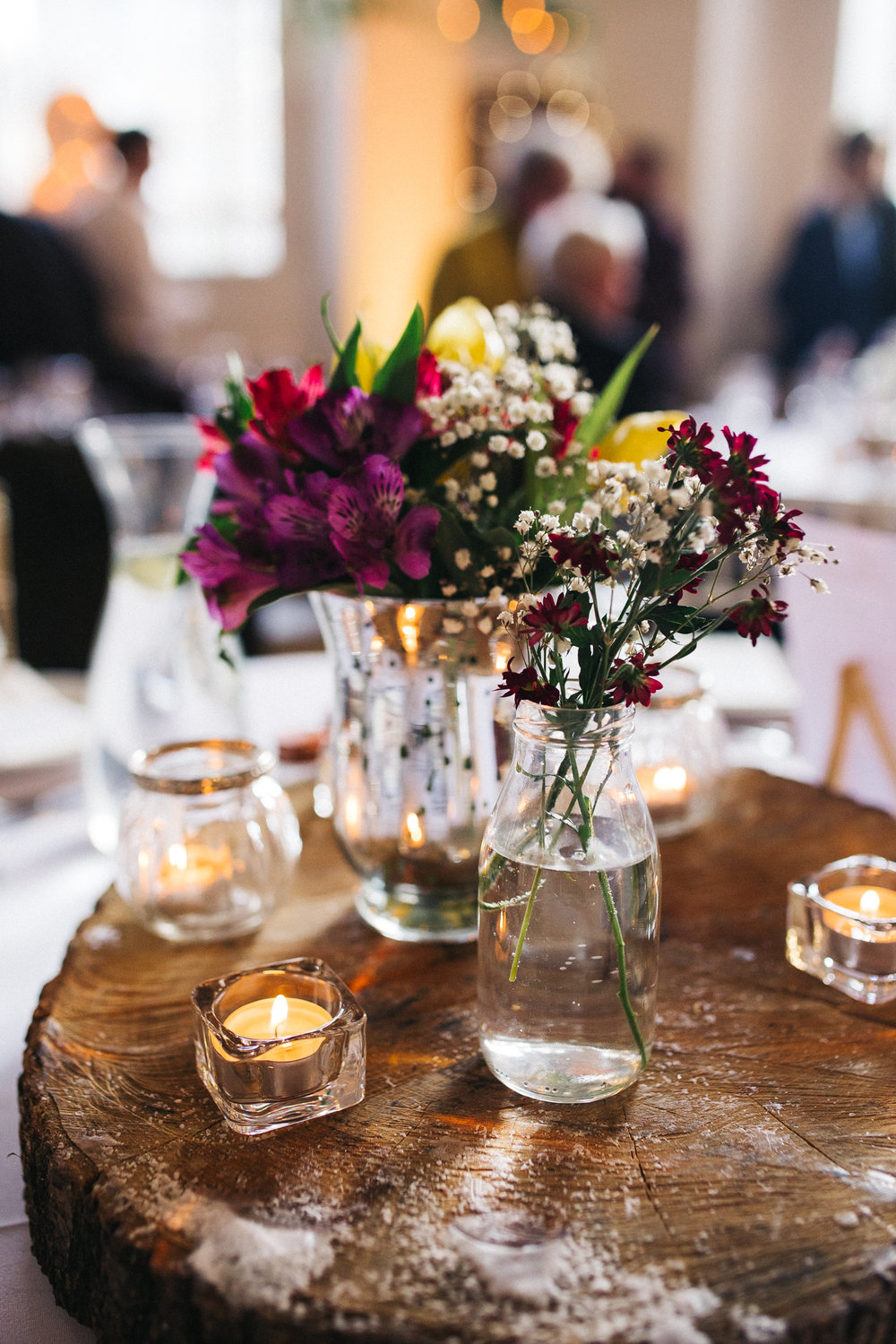 a close up shot of table decorations - wildflowers in glass vases. ceremony at st georges hall liverpool, oh me oh my wedding reception, north west wedding photographer