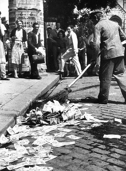 What is the opposite of this? Sweeping up in 1946 after the hyperinflation of the Hungarian pengő. Source: Wikimedia Commons, Magyar Nemzeti Múzeum Történeti Fényképtára, Budapest.