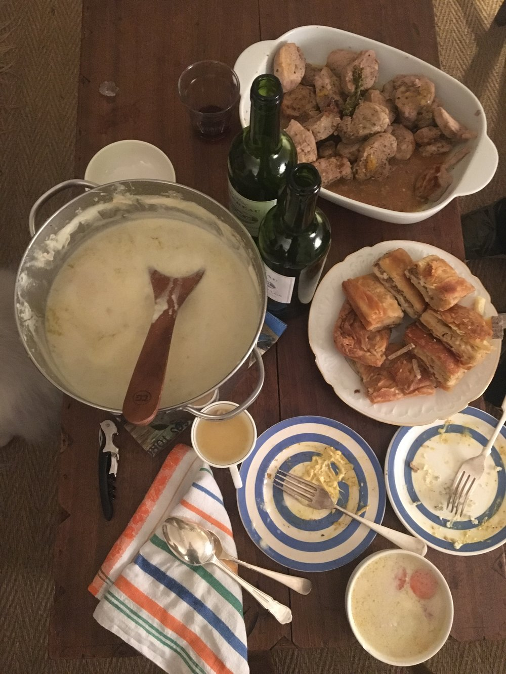 Chiken soup with pork and red whine near the fireplace