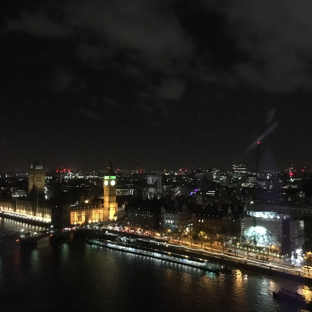View of Houses of Parliament at night from London Eye.