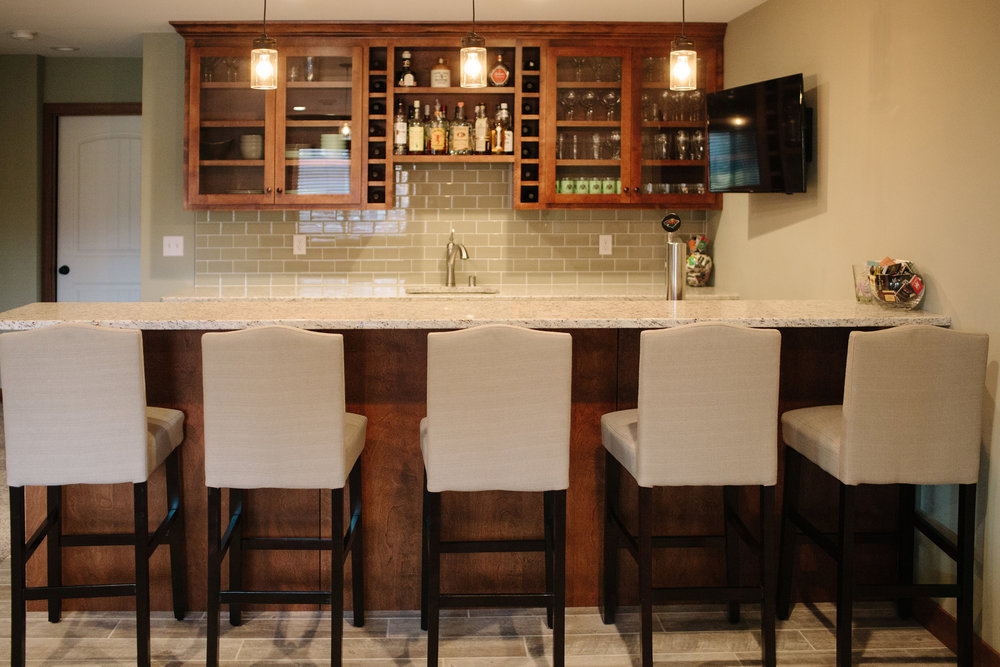 Bar in the Andover basement renovation by Professio