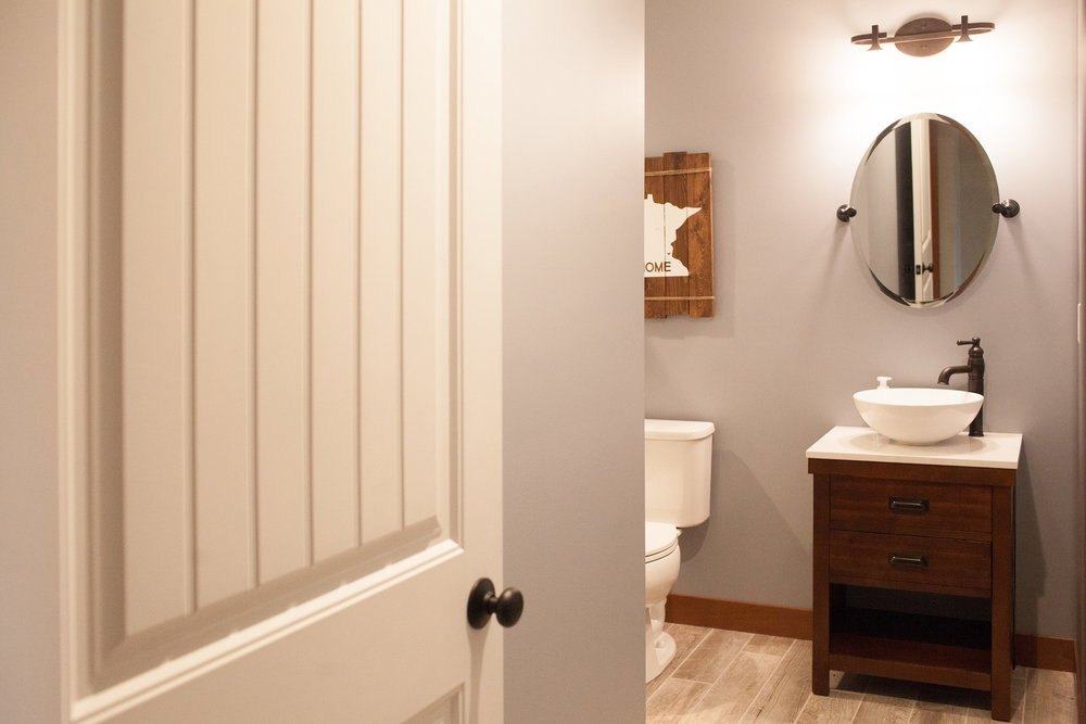 Three-quarter bath in Andover basement renovation by Professio