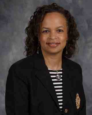 Sandra E. Moorman   Principal