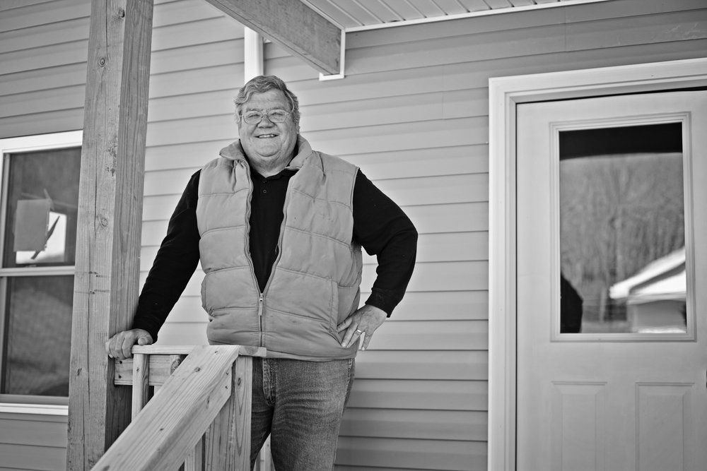 38 - Tom Crabtree and Rob Vass, both business owners in White Sulphur Springs, were sitting in their office, lit by candlelight, the evening after the flood when the idea of building a new neighborhoodfor flood victims came to them. By Thanksgiving they were cutting the ribbon on the first eight homes in Hope Village, a new community in White Sulphur Springs built through their organization Homes for White Sulphur Springs. When finished later this year, Hope Village will boast 38 homes for displaced flood victims.
