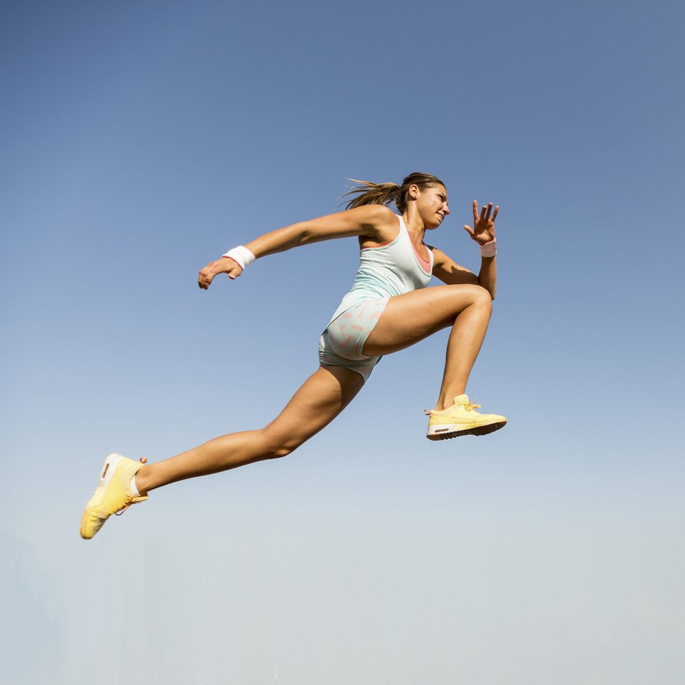 female-athlete-running-jumping