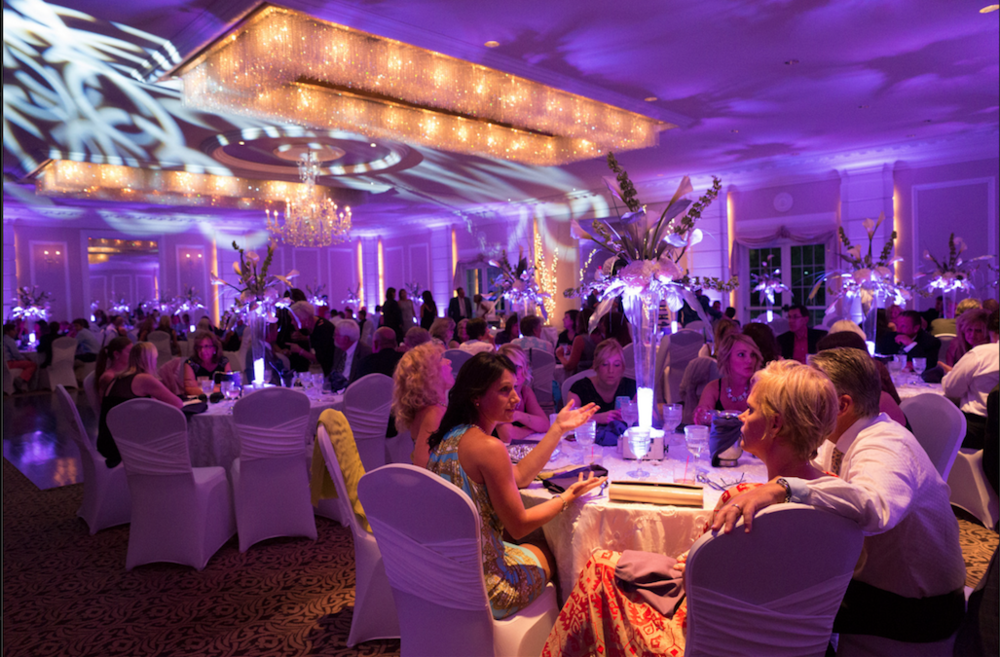 Purple Uplighting with our Luminate Dance Floor Lighting and Lighted Centerpieces.