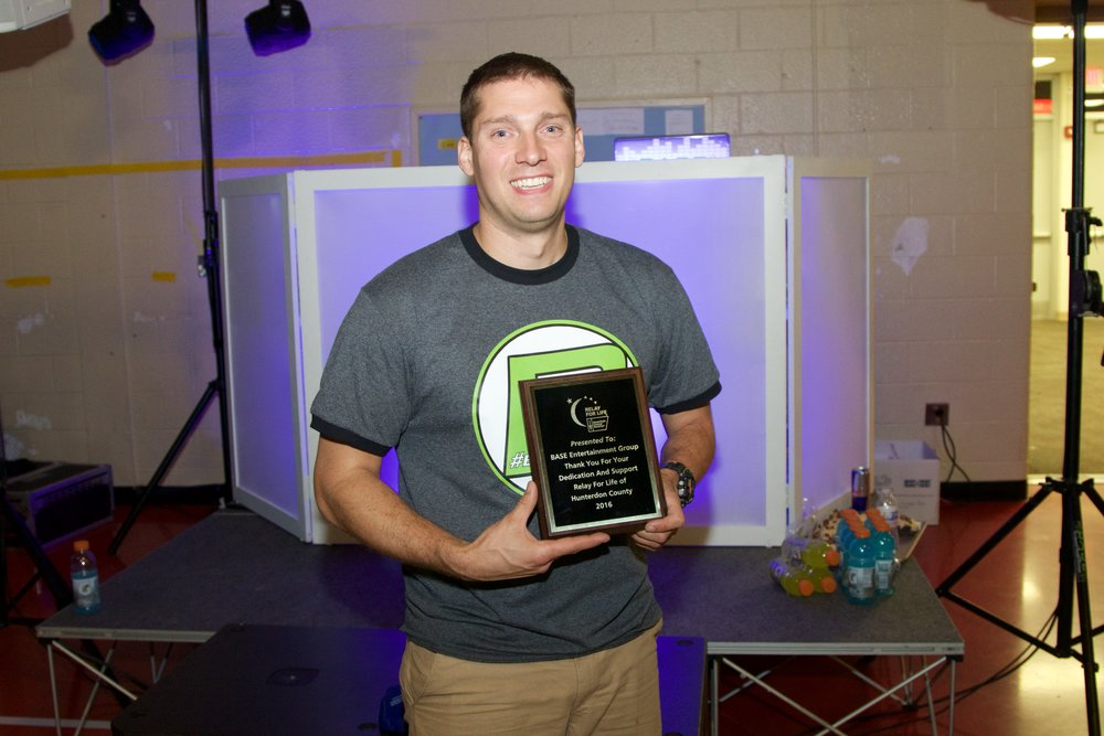 Rob Case (Owner) with an award from Relay for Life