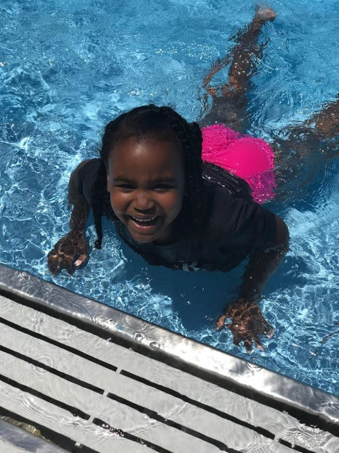 lil girl swimming.png