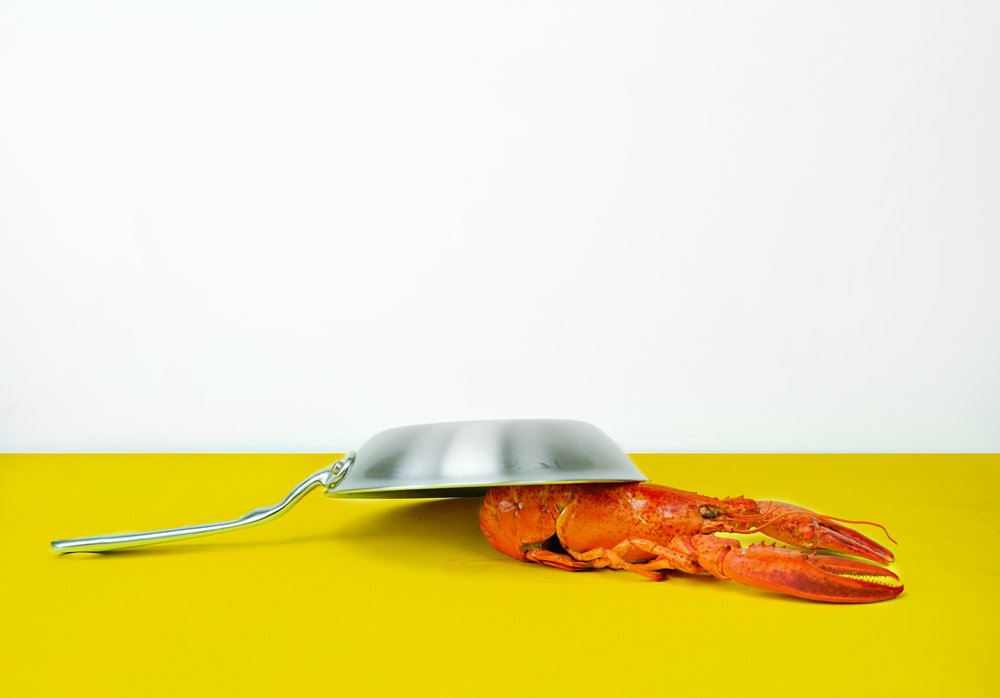 I am this lobster.  The chatter is slowing slaying me with this frying pan.  Sans butter.