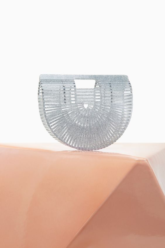 splurge - with this Cult Gaia acrylic arc bag