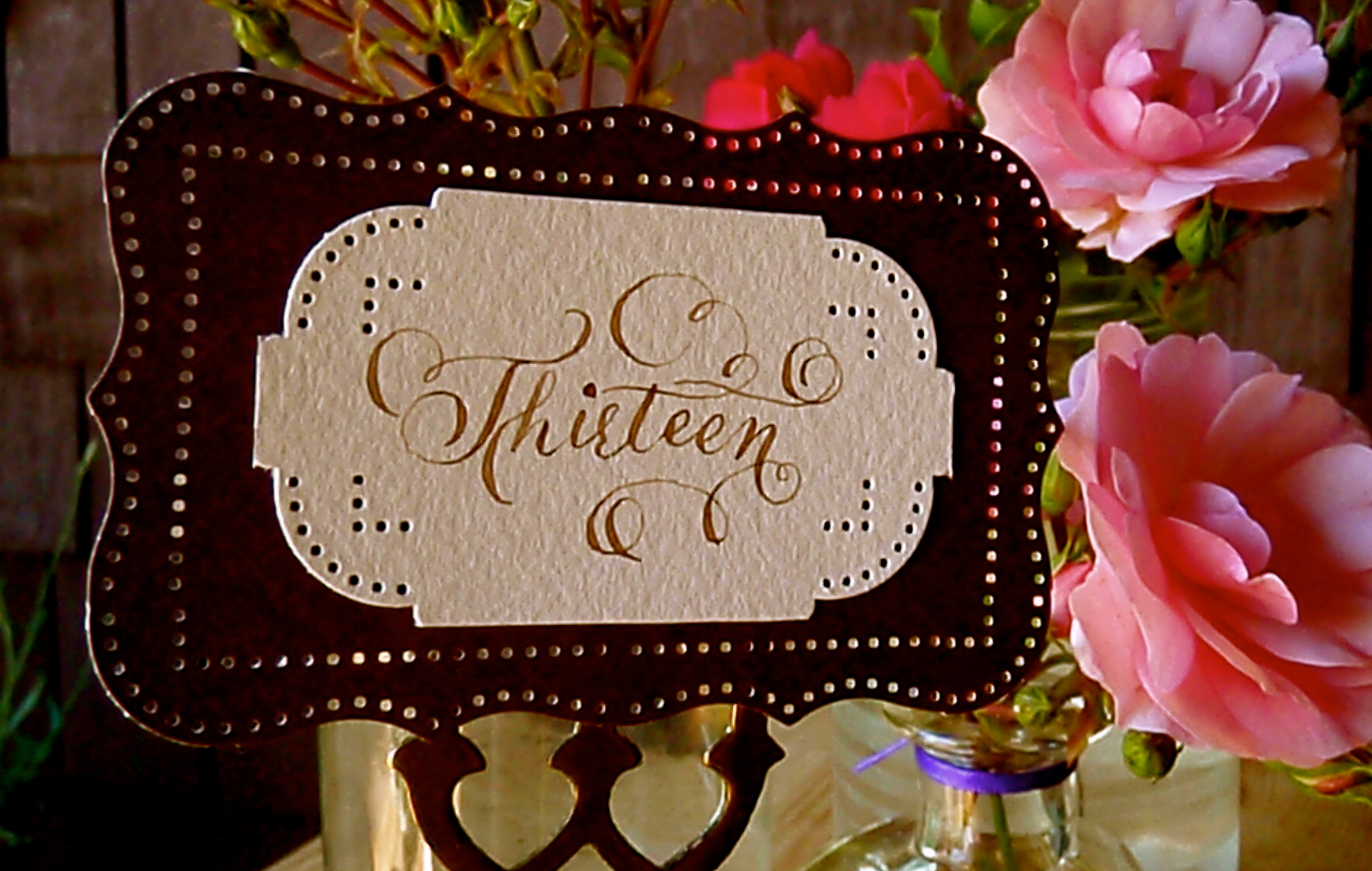 vintage style calligraphy hand letter roses table number