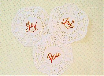 joy love peace Calligraphy on Doilies orange blue polka dots