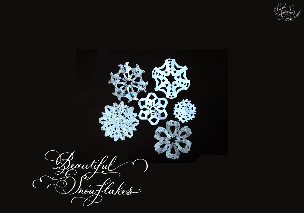 how to fold paper snowflakes