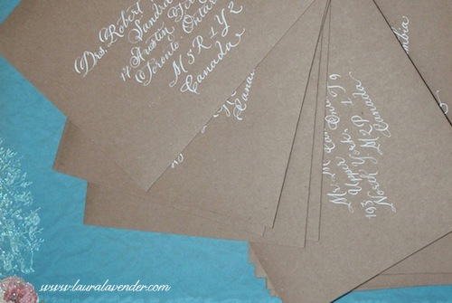 white ink calligraphy on kraft paper