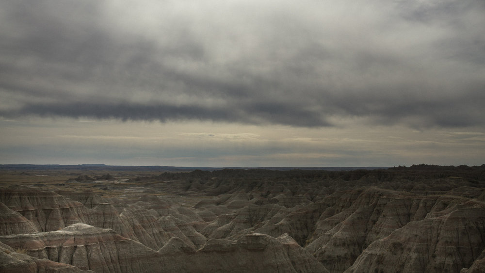 when we rolled into the badlands of south dakota, this extraordinary landscape held our tongues for miles…