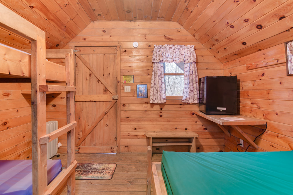 Twin bunks, full size bed, and small refrigerator in K3