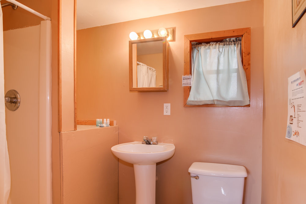 The bathroom has all the luxuries of home, including a toilet, sink, and shower (pictured).