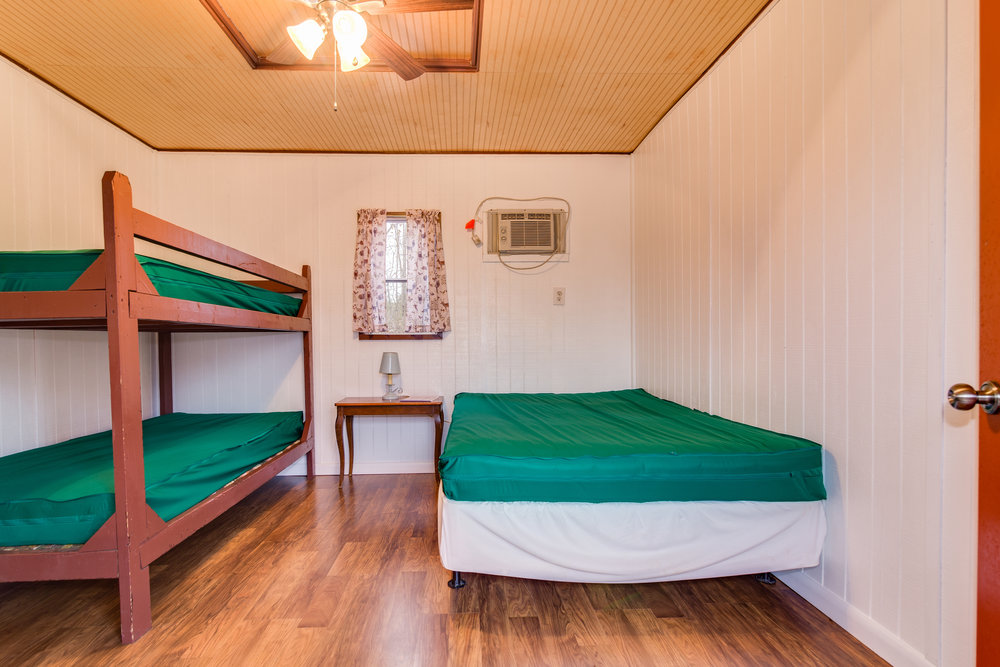 Full size bed and twin bunks in K2