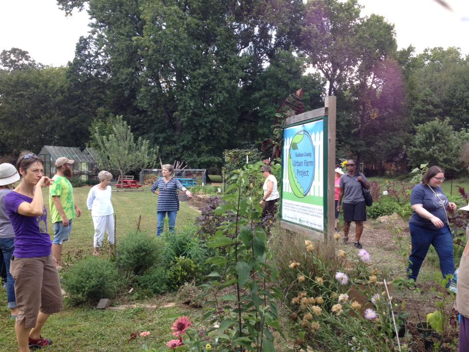 - At least once a year, The Locals invites visitors on a tour around farms in Faulkner County in order to connect consumers with the people who produce their food. Here, visitors are treated to an explanation about the perennial flower and herb bed surrounding the Faulkner County Urban Farm sign.