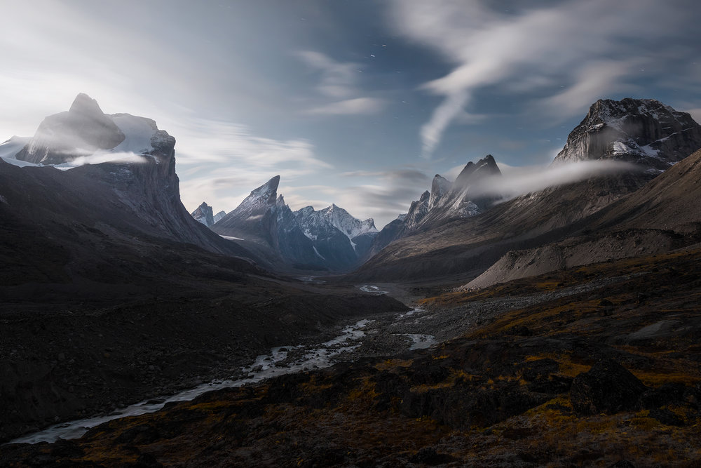 Mountains Breidablik (left) and Thor (that sharktooth out there) soar high above a moonlit valley inside Auyuittuq National Park on Baffin Island.