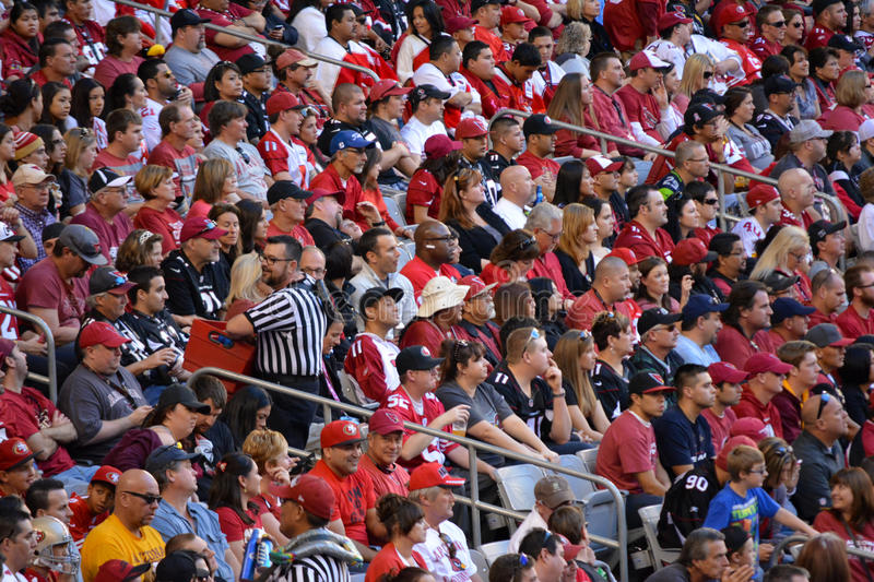 crowd-people-football-game-sitting-stadium-seats-47490416.jpg