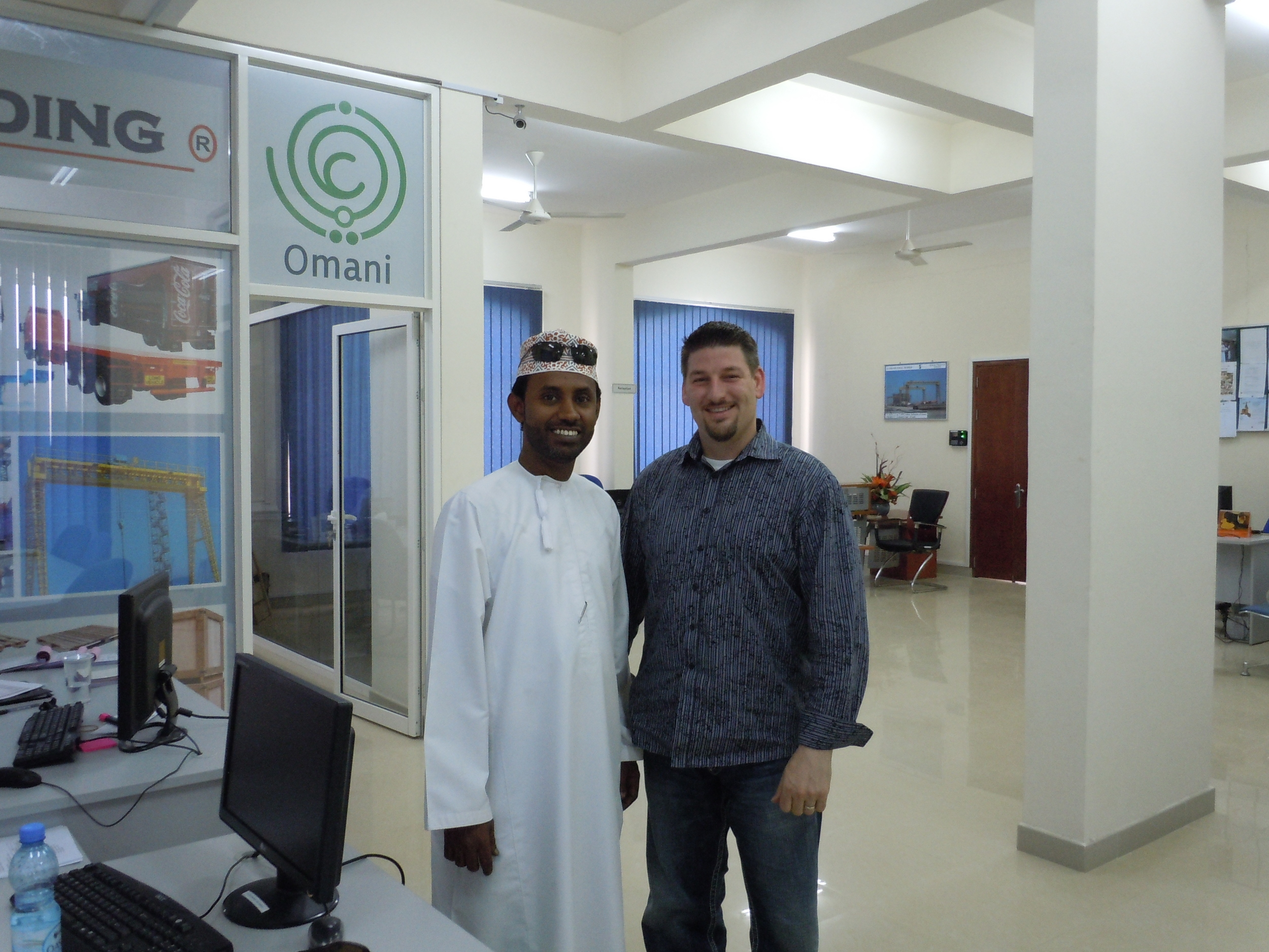 Dr. Brian Williams develops international trade with Omar Bawain from Oman.