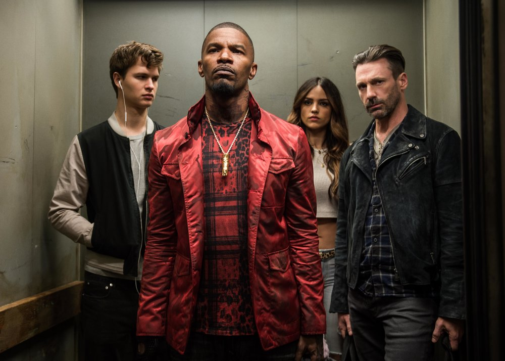 (Caption: (l to r) Baby (ANSEL ELGORT), Bats (JAMIE FOXX), Darling (EIZA GONZALEZ) and Buddy (JON HAMM) decide on doing the heist in TriStar Pictures' BABY DRIVER. | Credit: Wilson Webb)