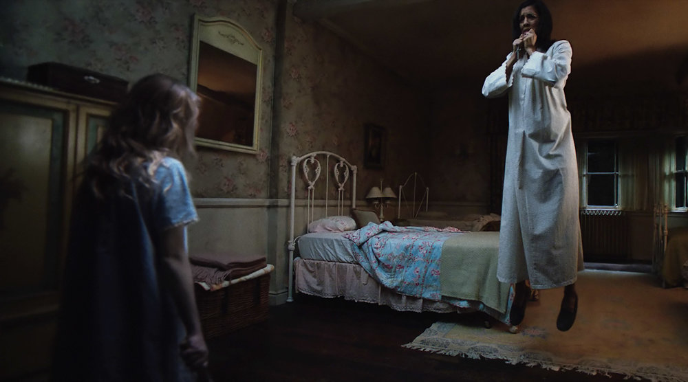 (L-R) Talitha Bateman as Janice and Stephanie Sigman as Sister Charlotte in New Line Cinema's supernatural thriller ANNABELLE: CREATION, a Warner Bros. Pictures release. (Photo Credit: Courtesy of Warner Bros. Pictures)