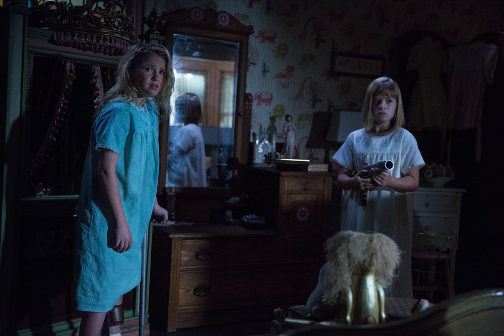 (L-R) Talitha Bateman as Janice and Lulu Wilson as Linda in New Line Cinema's supernatural thriller ANNABELLE: CREATION, a Warner Bros. Pictures release (Photo Credit: Justin Lubin)