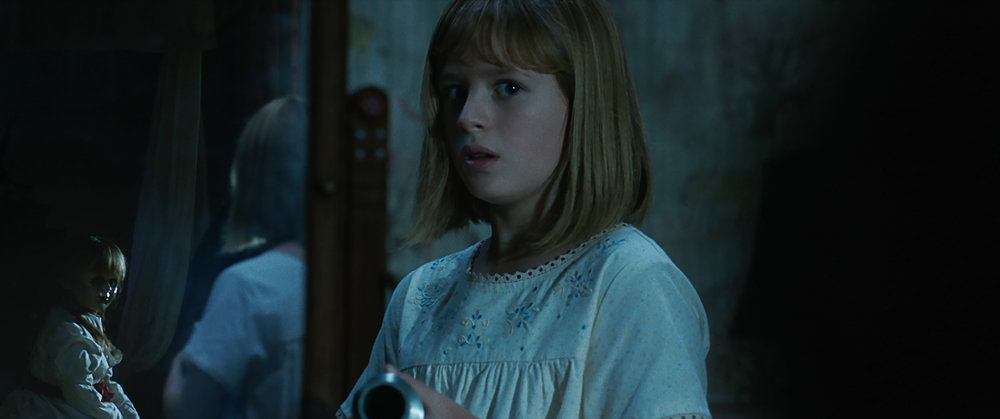 (L-R) The Annabelle doll and Lulu Wilson as Linda in New Line Cinema's supernatural thriller ANNABELLE: CREATION, a Warner Bros. Pictures release