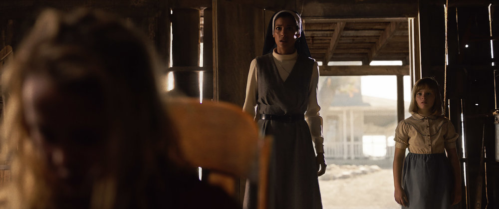 (L-R) Stephanie Sigman as Sister Charlotte and Lulu Wilson as Linda in New Line Cinema's supernatural thriller ANNABELLE: CREATION, a Warner Bros. Pictures release (Photo Credit: Courtesy of Warner Bros. Pictures).