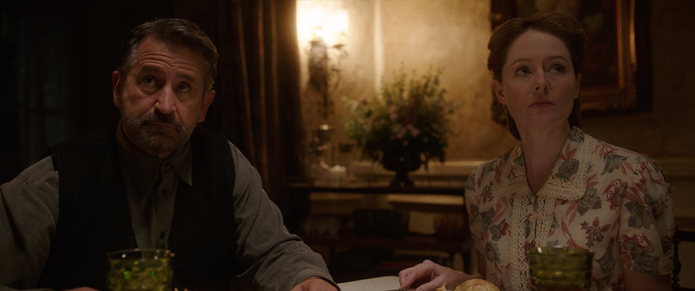 (L-R) Anthony LaPaglia as Samuel Mullins and Miranda Otto as Esther Mullins in New Line Cinema's supernatural thriller ANNABELLE: CREATION, a Warner Bros. Pictures release (Photo Credit: Courtesy of Warner Bros. Pictures)