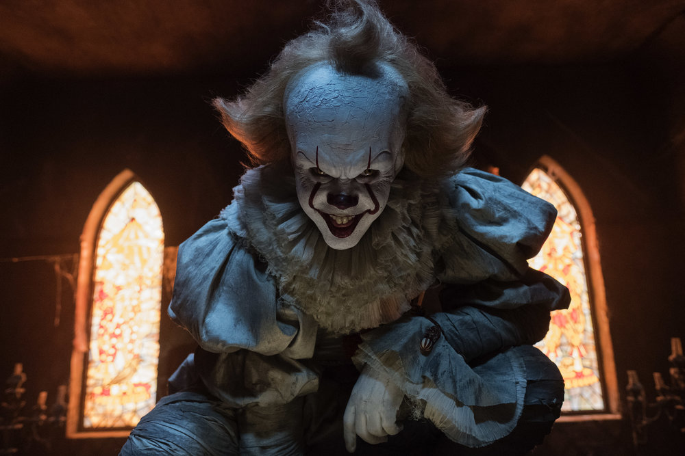 "Bill Skarsgard as Pennywise in New Line Cinema's horror thriller ""IT,"" a Warner Bros. Pictures release (Photo Credit: Brooke Palmer)"