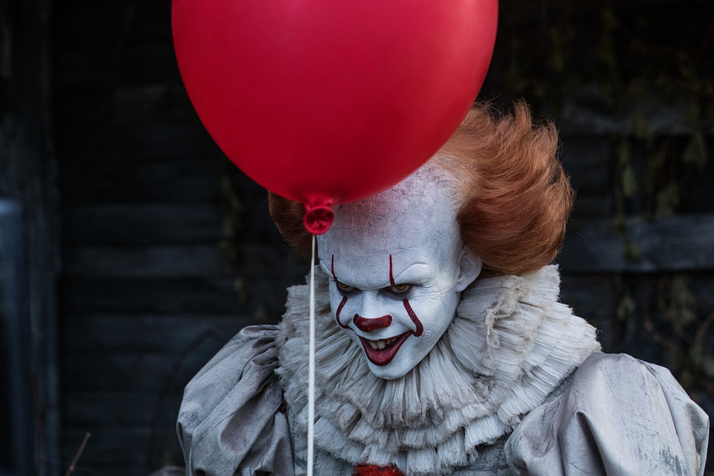 "Bill Skarsgard as Pennywise in New Line Cinema's horror thriller ""IT,"" a Warner Bros. Pictures release. (Photo Credit: Brooke Palmer)"