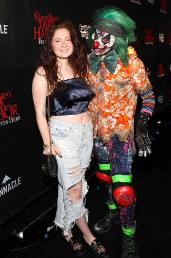Shameless star, Emma Kenney, poses with Slider at Dark Harbor Media & VIP Preview on September 28, 2017