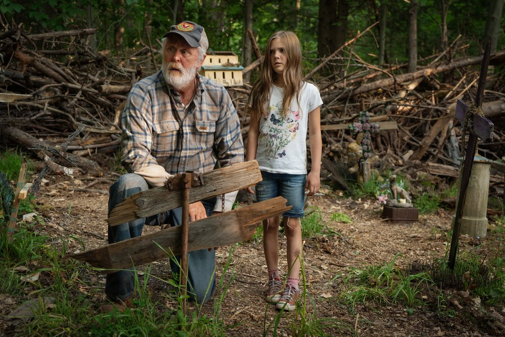 John Lithgow as Jud and Jeté Laurence as Ellie in PET SEMATARY | Photo Credit: Kerry Hayes