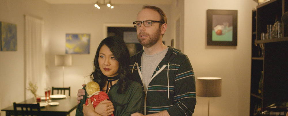 Constance Wu and Morgan Peter Brown in ALL THE CREATURES WERE STIRRING | Photo Courtesy of RLJE Films