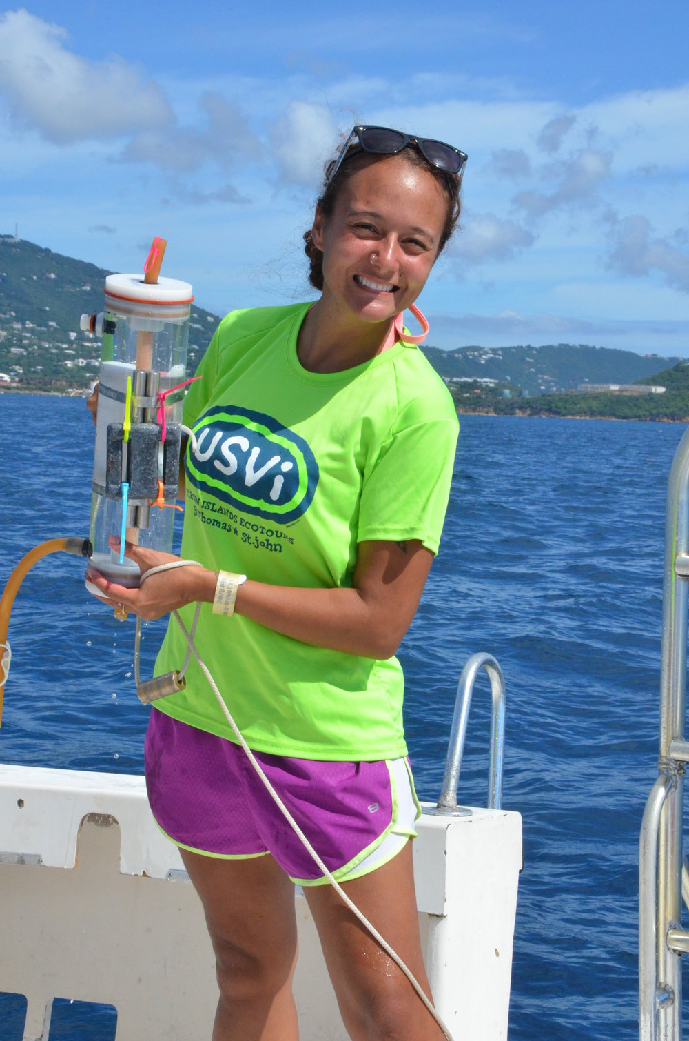 Mara prepares to deploy a Niskin which tests for nutrients, bacteria and total suspended solids in the water.