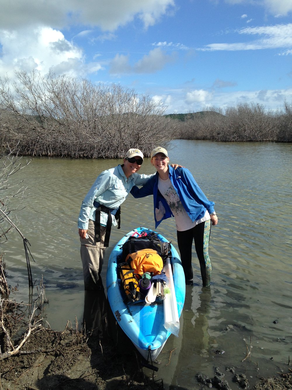 Allie Durdall and Dr. Grimes are ready to head out to one of the field sites with their kayak filled with gear