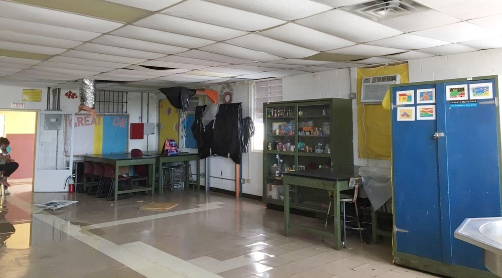 Ms. Ravalier's high school science classroom, as of late September 2017.  The floor was flooded, and ceiling tiles were full of moisture, damaged, or molding.  Some of the classroom contents were damaged, such as the projector and most art supplies.   Photo by Michealrose Ravalier