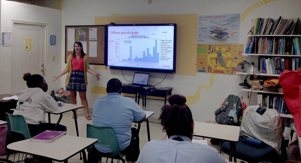 Katharine Egan discusses U.S. Virgin Islands marine debris data with students at Charlotte Amalie High School.